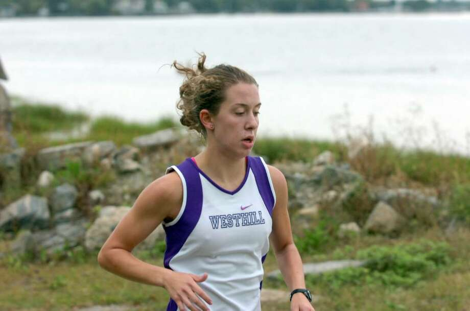 Westhill Cross Country team's Maddie Elkins breezes around Tod's Point during the Greenwich High School Cross Country Meet Tuesday afternoon, Sept. 22, 2009. Photo: Keelin Daly / Greenwich Time