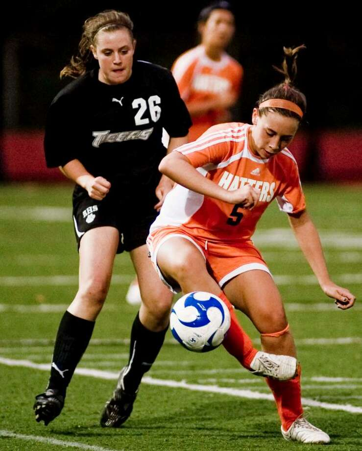 Ridgefield junior Sarah Kreps and Danbury junior Megan Jakobson try to control the ball during the girls soccer game at Ridgefield. Tuesday, Sept. 22, 2009 Photo: Scott Mullin / The News-Times