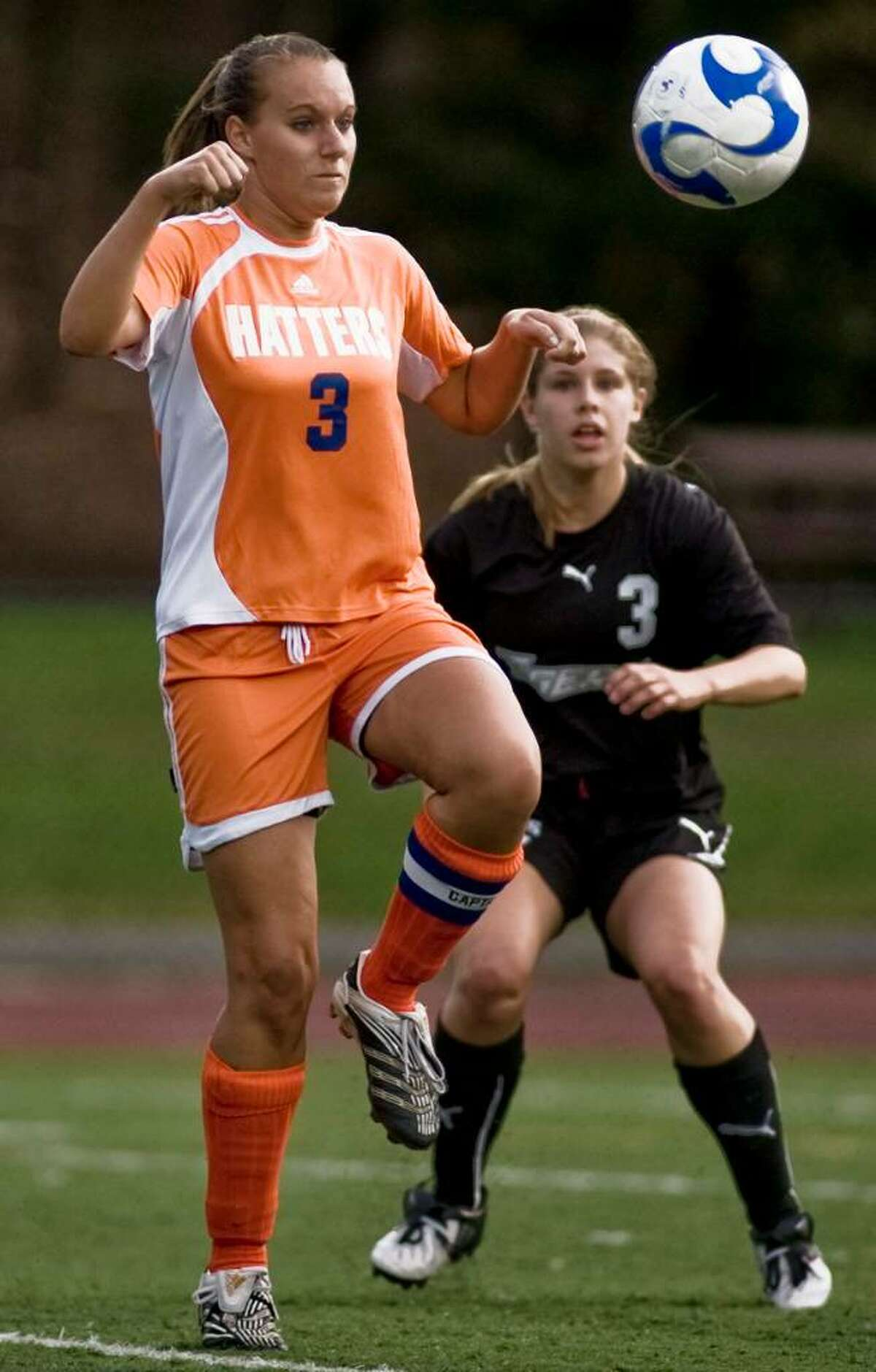 Danbury senior Melissa Michaelis taking the ball from the air with Ridgefield senior Kaitlin Gerber watching the play at the girls soccer game at Ridgefield. Tuesday, Sept. 22, 2009