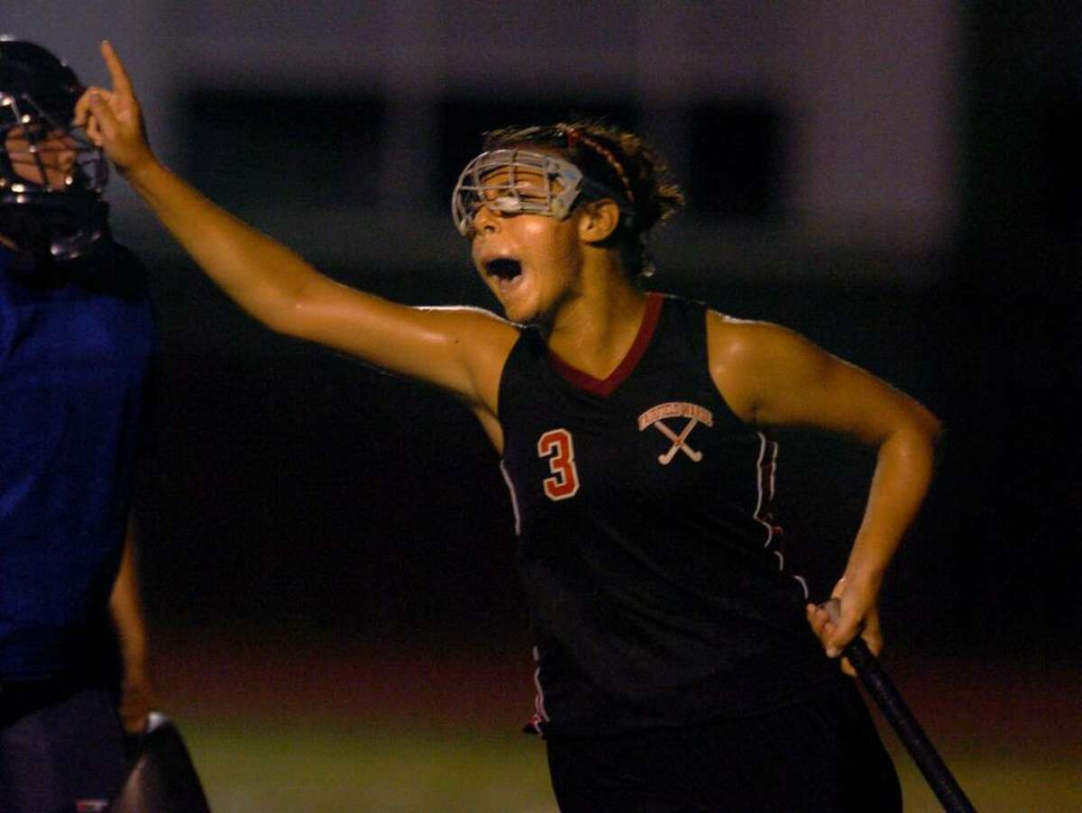 Fairfield Warde's Christie Zierolf reacts after scoring the game winning shot in overtime during Tuesday night's field hockey match against Ludlowe.