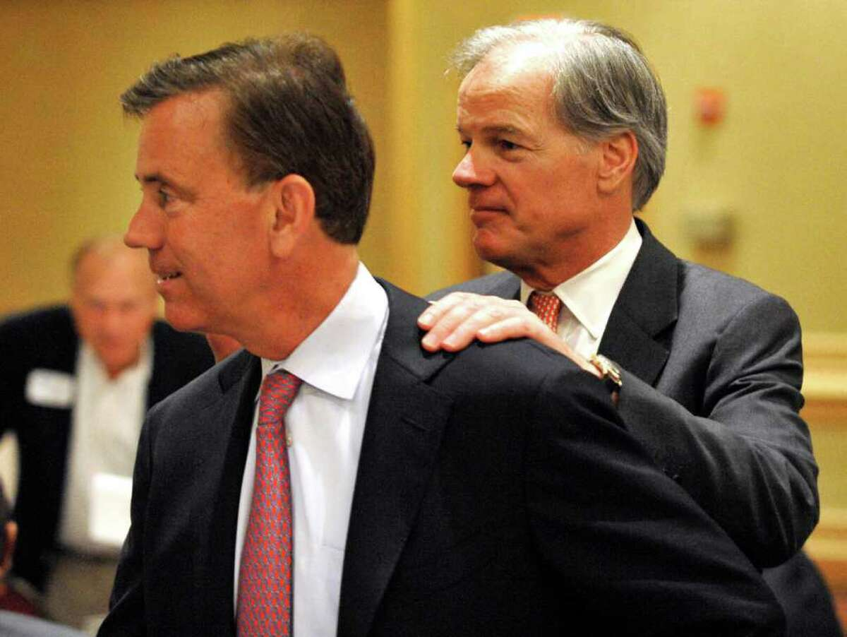 Gubernatorial candidate Ned Lamont, left, is greeted by fellow candidate Tom Foley in Stamford on June 29, 2010. (AP Photo/Douglas Healey)