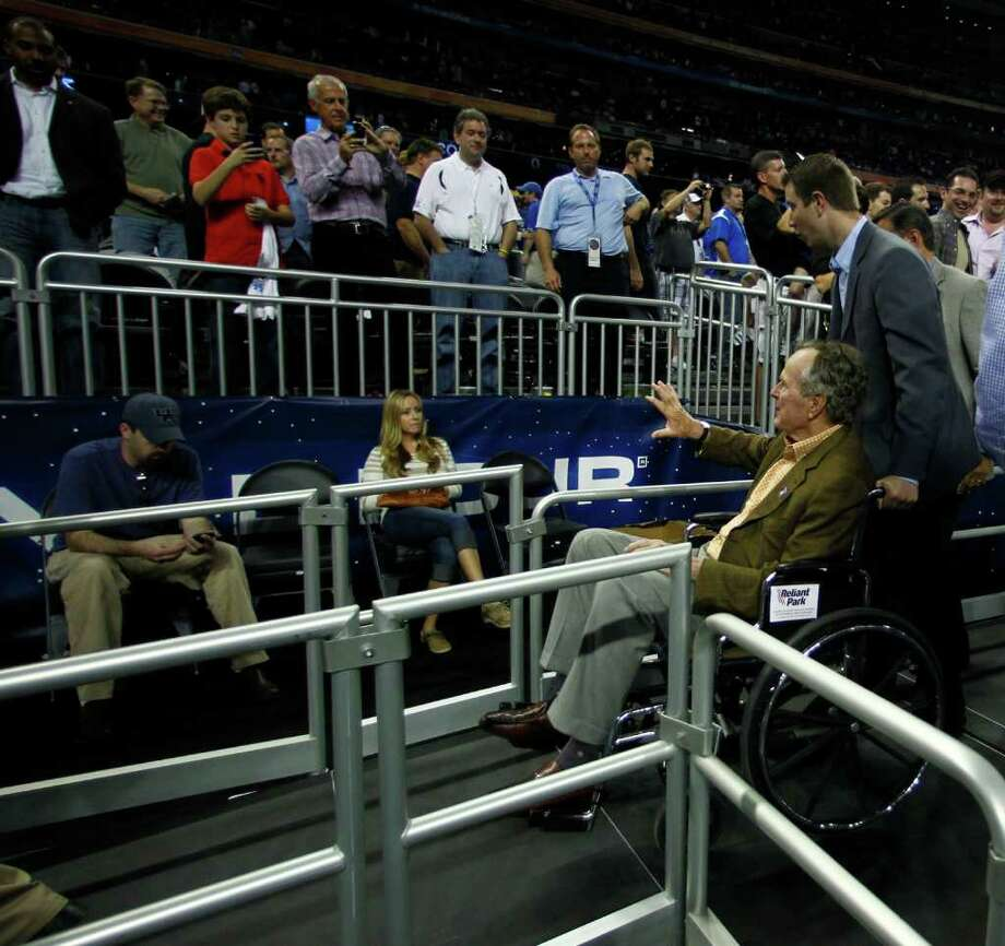 Former President George H.W. Bush waves to the crowd after the game between Butler and Virginia Commonwealth in the NCAA National Semifinals at Reliant Stadium on Saturday, April 2, 2011, in Houston.  Butler won 70-62 and will advance to the championship game.  ( Nick de la Torre / Houston Chronicle ) Photo: Nick De La Torre, Houston Chronicle For The Connecticut Post / Houston Chronicle for the Connecticut Post