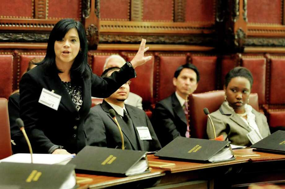 Marybeth Melendez, 44, of Staten Island, left, makes her point as she participates as a state senator in Somos el Futuro on Saturday, April 2, 2011, at the Capitol in Albany, N.Y. The event's purpose is to increase Hispanic participation in the public-policy-making process. (Cindy Schultz / Times Union) Photo: Cindy Schultz