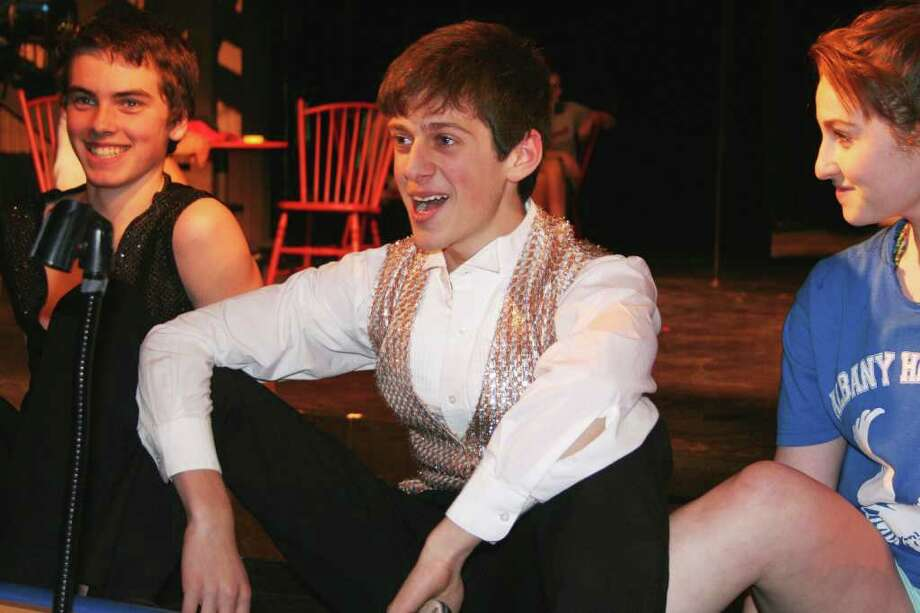 The students in the photo are, from left to right, Lucas Phayre, Nikolai Mishler and Bess Zafran. Mishler plays one of the leads in the play: Master of Ceremonies. (Courtesy Albany High)