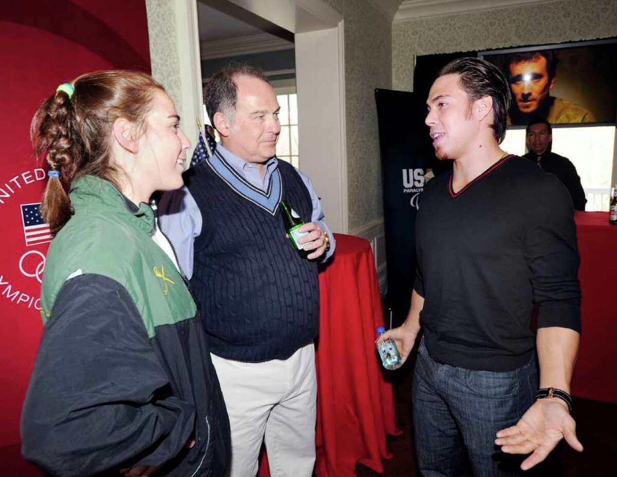 From left, Parker Procida and her father, Mario, speak with Apolo Anton Ohno, an American short-track speedskating gold medalist in the 2002 and 2006 Winter Olympics, during a U.S. Olympic Committee exclusive donor reception at the Greenwich home of the Procidas, Saturday night, April 2, 2011. Mario's wife is Perri S. Procida, who is a U.S. Olympic Foundation trustee.