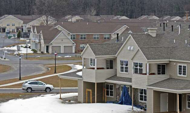 View of the Renaissance Apartments, foreground right, and the Saratoga Heritage Apartments, visible across Route 9, on Thursday, March 31, 2011, in Wilton, NY.  ( Philip Kamrass/ Times Union ) Photo: Philip Kamrass