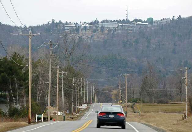 A car drives on Northern Pines Road within sight of the Mount McGregor Correctional Facility on Thursday, March 31, 2011, in Wilton, NY.  ( Philip Kamrass/ Times Union ) Photo: Philip Kamrass