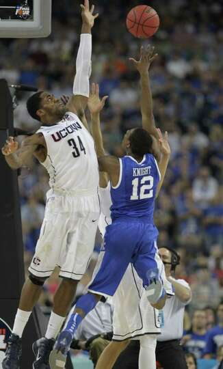 Connecticut center Alex Oriakhi (34) defends against Kentucky guard Brandon Knight (12) during the s