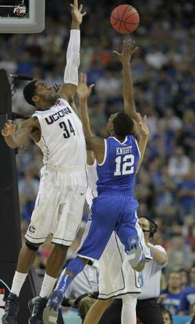 Connecticut center Alex Oriakhi (34) defends against Kentucky guard Brandon Knight (12) during the second half of the NCAA National Semifinals at Reliant Stadium onSaturday, April 2, 2011, in Houston. ( Karen Warren / Houston Chronicle ) Photo: Karen Warren, Houston Chronicle For The Connecticut Post / Houston Chronicle for the Connecticut Post