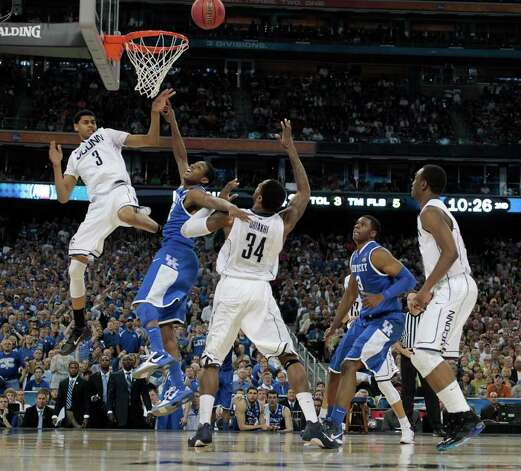 Kentucky guard Brandon Knight, left, battles through traffic with Connecticut forward Jeremy Lamb (3) and Connecticut center Alex Oriakhi (34) during the second half of the NCAA National Semifinals at Reliant Stadium on Saturday, April 2, 2011, in Houston.  ( Nick de la Torre / Houston Chronicle ) Photo: Nick De La Torre, Houston Chronicle For The Connecticut Post / Houston Chronicle for the Connecticut Post
