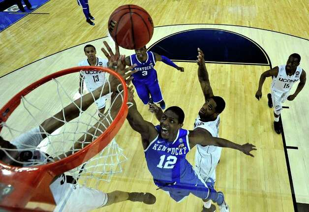 HOUSTON, TX - APRIL 02:  Brandon Knight #12 of the Kentucky Wildcats goes to the hoop against Alex Oriakhi #34 of the Connecticut Huskies during the National Semifinal game of the 2011 NCAA Division I Men's Basketball Championship at Reliant Stadium on April 2, 2011 in Houston, Texas.  (Photo by Chris Steppig-Pool/Getty Images) *** Local Caption *** Brandon Knight;Alex Oriakhi Photo: Pool, Getty Images / 2011 Getty Images