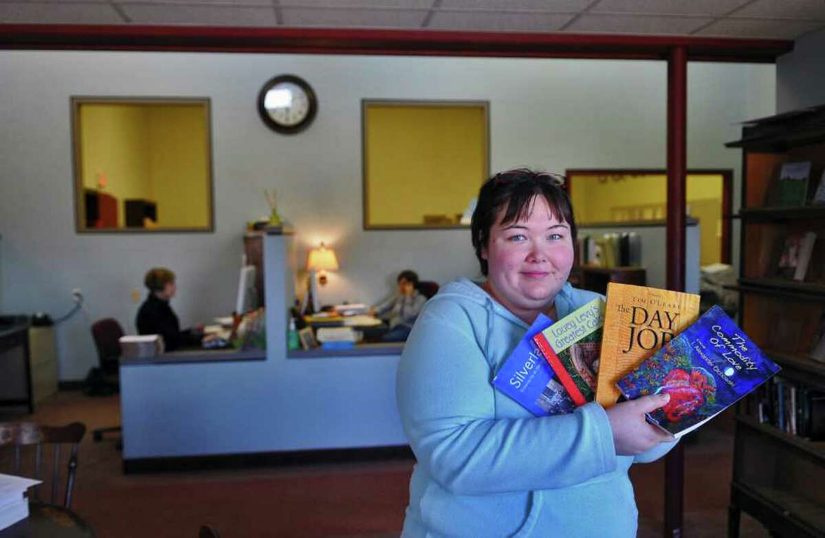 Melissa Mykal Batalin, Art Director and Manager of The Troy Book Maker, holds several of their books in their office on Wednesday March 30, 2011 in Troy, NY. They are one of several businesses in Troy owned by women. ( Philip Kamrass/ Times Union )