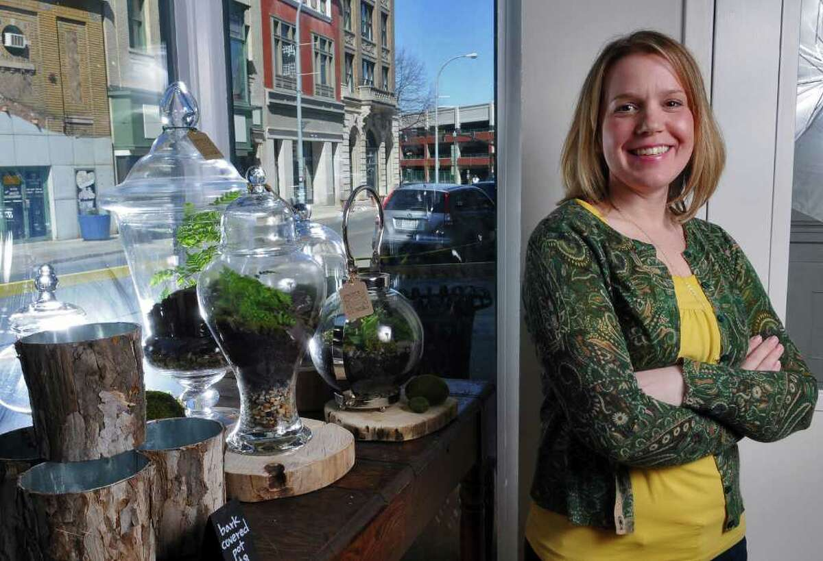 Dawn Gagne, owner of The Botanic Studio, stands near some of the terrariums she made and sells in her nearly month old store on River Street, on Wednesday March 30, 2011 in Troy, NY. Hers is one of several businesses in Troy owned by women. ( Philip Kamrass/ Times Union )