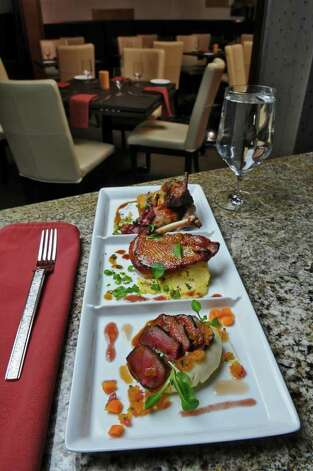Wild Game Night, at Taste in Albany, N.Y., includes stuffed quail, Guinness-brined antelope and chamomile-dusted pheasant. (Philip Kamrass/ Times Union) Photo: Philip Kamrass