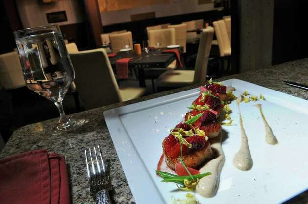 Seared Diver Scallops at Taste, a restaurant in downtown Albany on Monday March 28, 2011, in Albany, N.Y. (Philip Kamrass/ Times Union) Photo: Philip Kamrass