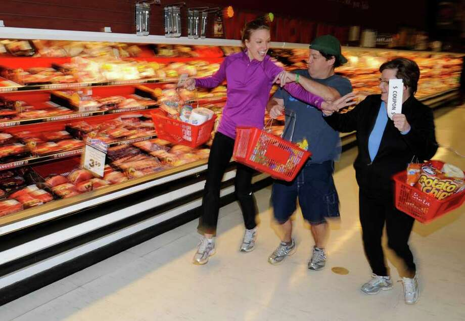 From left: Kristi Gustafson, Chris Churchill and Ruth Fantasia fight for deals at a Price Chopper store in Albany. (Skip Dickstein / Times Union) Photo: Skip Dickstein