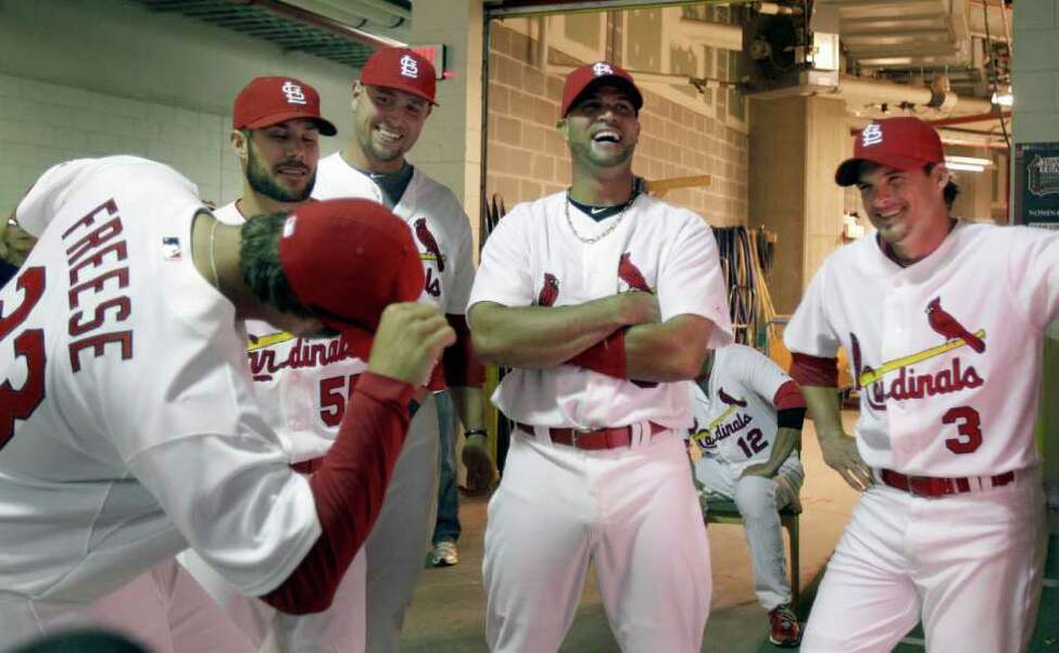 St. Louis Cardinals' David Freese, left, jokes with teammates, continuing from left to right, Skip Schumaker, Matt Holliday, Albert Pujols and Ryan Theriot as they wait under the stadium to be introduced before the start of a baseball game against the San Diego Padres on opening day Thursday, March 31, 2011, in St. Louis. (AP Photo/Jeff Roberson)