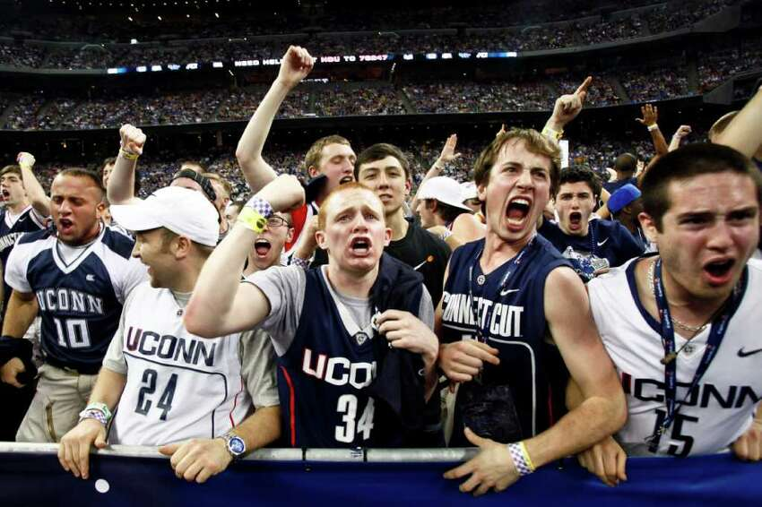 Brendan Fitzpatrick (center) reacts during the final minutes of Connecticut's win over Kentucky in the NCAA National Semifinals basketball game at Reliant Stadium on Saturday, April 2, 2011, in Houston. ( Michael Paulsen / Houston Chronicle )