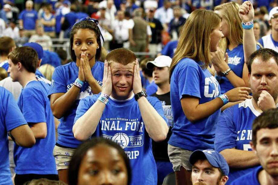 A Kentucky fans reacts during the final minutes of Kentucky's loss to Connecticut in the NCAA National Semifinals basketball game at Reliant Stadium on Saturday, April 2, 2011, in Houston.  ( Michael Paulsen / Houston Chronicle ) Photo: Michael Paulsen, Houston Chronicle For The Connecticut Post / Houston Chronicle for the Connecticut Post