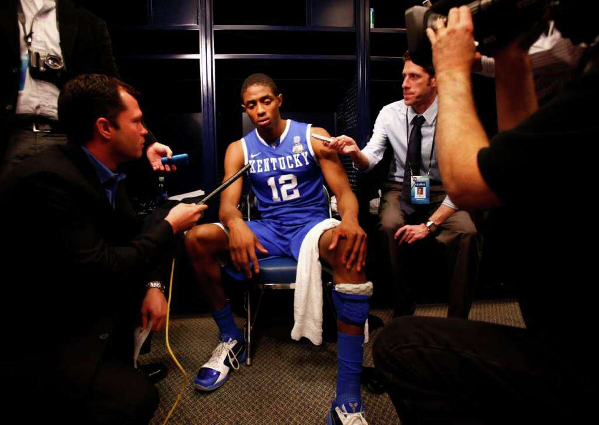 Kentucky guard Brandon Knight (12) talks to the media after the NCAA National Semifinals at Reliant Stadium on Saturday, April 2, 2011, in Houston. Connecticut won 56-55. ( Michael Paulsen / Houston Chronicle )