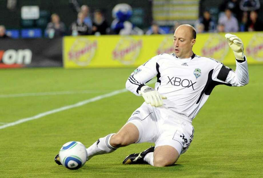 Kasey Keller of the Seattle Sounders FC slides to kick the ball away from his goal against the San Jose Earthquakes during an MLS soccer game at Buck Shaw Stadium in Santa Clara, Calif., on Saturday, April 2, 2011. (Photo by Thearon W. Henderson/Getty Images) Photo: Thearon W. Henderson, Getty Images / 2011 Getty Images