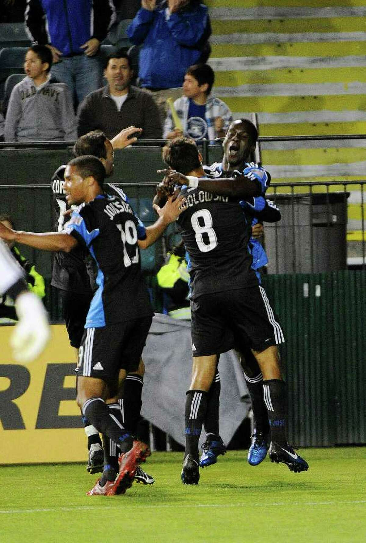 Simon Dawkins #10 of the San Jose Earthquakes after scoring a goal celebrates with teammate Chris Wondolowski against the Seattle Sounders FC. (Photo by Thearon W. Henderson/Getty Images)
