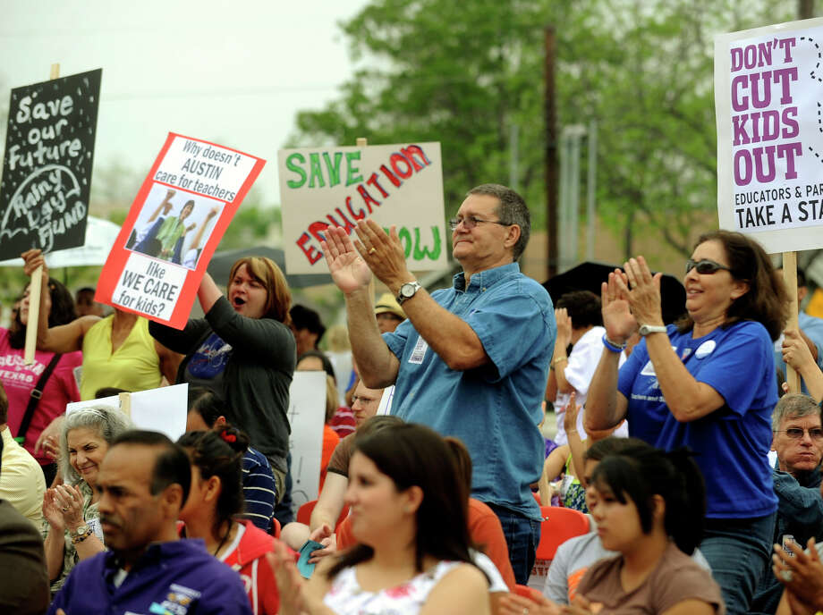 "A speaker is applauded at the Texas State Teachers Association's ""Don't Cut Kids Out"" rally at Brackenridge High on Saturday. The education cuts proposed in House Bill 1 also were opposed at similar events in other cities. Photo: BILLY CALZADA/gcalzada@express-news.net"
