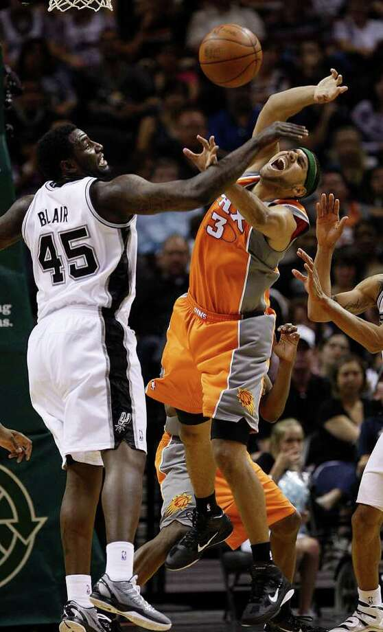 SPURS -- San Antonio Spurs DeJuan Blair blocks a shot by Phoenix Suns Jared Dudley during the second half at the AT&T Center, Sunday, April 3, 2011. The Spurs won 114-97. JERRY LARA/glara@express-news.net Photo: JERRY LARA / SAN ANTONIO EXPRESS-NEWS (NFS)