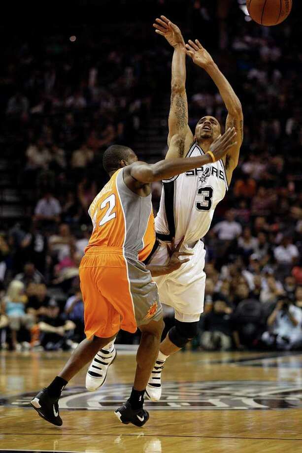SPURS -- San Antonio Spurs George Hill is fouled for a three-point attempt by Phoenix Suns Zabian Dowdell during the first half at the AT&T Center, Sunday, April 3, 2011. JERRY LARA/glara@express-news.net / SAN ANTONIO EXPRESS-NEWS (NFS)