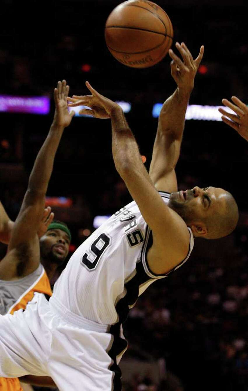 SPURS -- San Antonio Spurs Tony Parker goes for a rebound against Phoenix Suns Jared Dudley during the first half at the AT&T Center, Sunday, April 3, 2011. JERRY LARA/glara@express-news.net