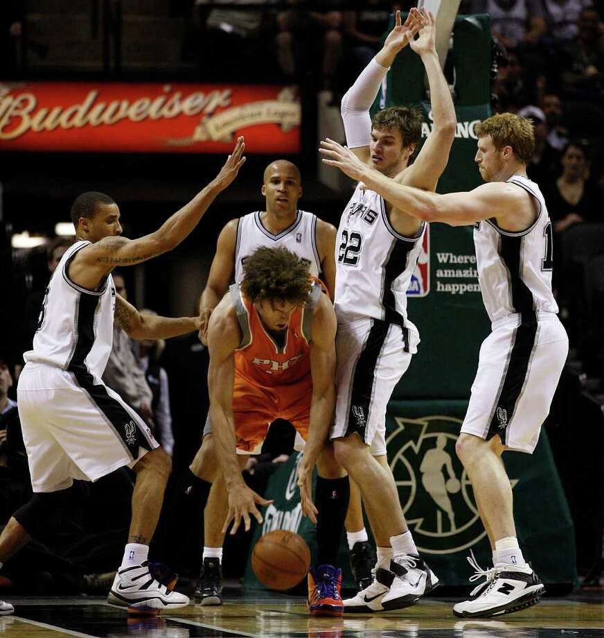 SPURS -- San Antonio Spurs, from left, George Hill, Richard Jefferson, Tiago Splitter and Matt Bonner surround Phoenix Suns Robin Lopez during the second half at the AT&T Center, Sunday, April 3, 2011. The Spurs won 114-97. JERRY LARA/glara@express-news.net Photo: JERRY LARA, San Antonio Express-News / SAN ANTONIO EXPRESS-NEWS (NFS)