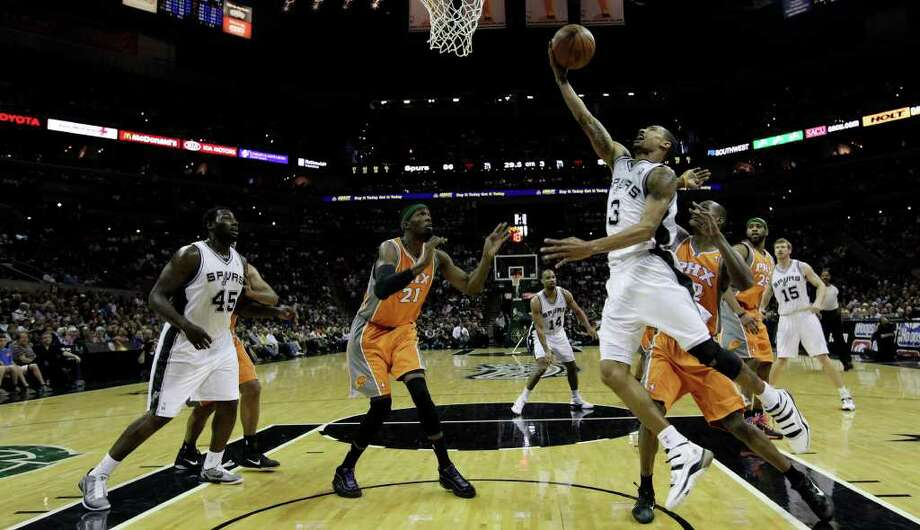 SPURS -- San Antonio Spurs George Hill drives to the goal against the Phoenix Suns during the second half at the AT&T Center, Sunday, April 3, 2011. The Spurs won 114-97. Hill ended up with a game-high of 29 points. JERRY LARA/glara@express-news.net Photo: JERRY LARA, San Antonio Express-News / SAN ANTONIO EXPRESS-NEWS (NFS)