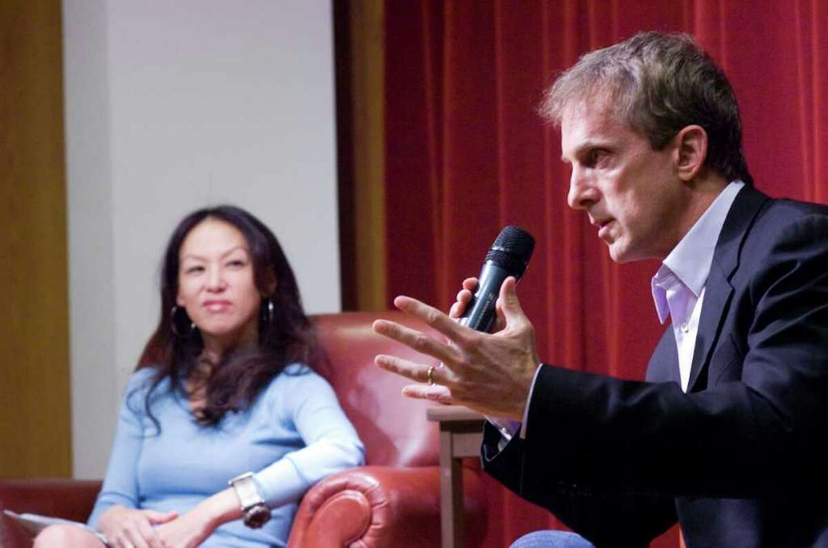 """Husband-and-wife authors Jed Rubenfeld and Amy Chua speak about their books """"The Death Instinct """" and """"Battle Hymn of the Tiger Mother"""" at New Canaan Library in New Canaan, Conn., April 3, 2011."""