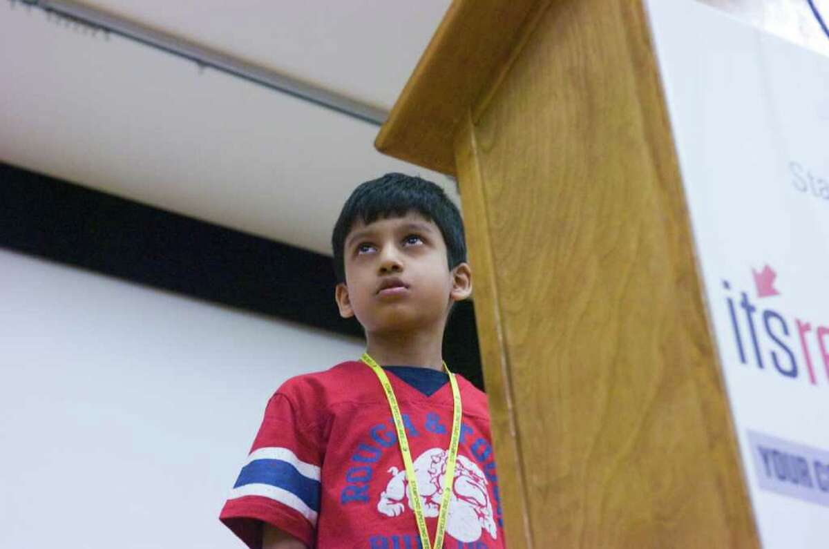 Fourth grader Harsha Kolachina works his way to victory during the First Annual Stamford Spelling Bee at the Ferguson Library in Stamford, Conn., April 3, 2011.
