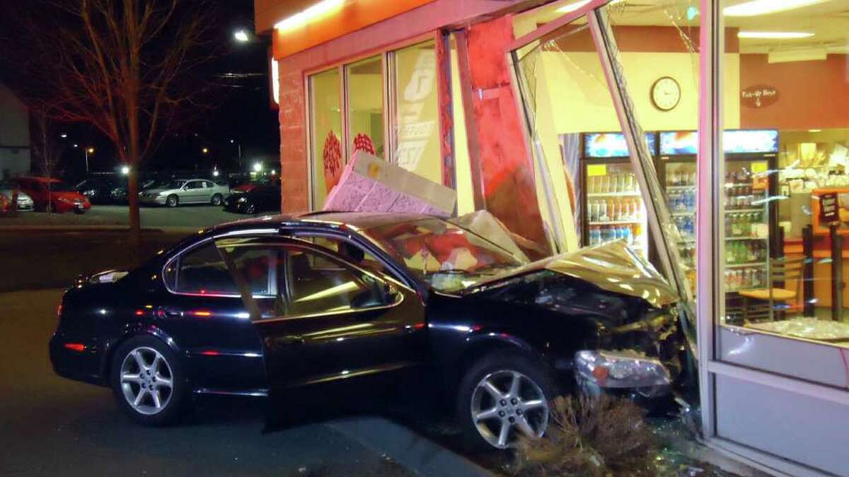 The Norwalk Fire Department responded to a car into a building this morning just after 2:30 am. Two patrons sitting at a table inside the Dunkin Donuts, located at 195 Main Avenue Norwalk were struck and thrown across the floor when the car hit the building. The Nissan Maxima's left front tire came to rest at the spot where the patrons table was located.