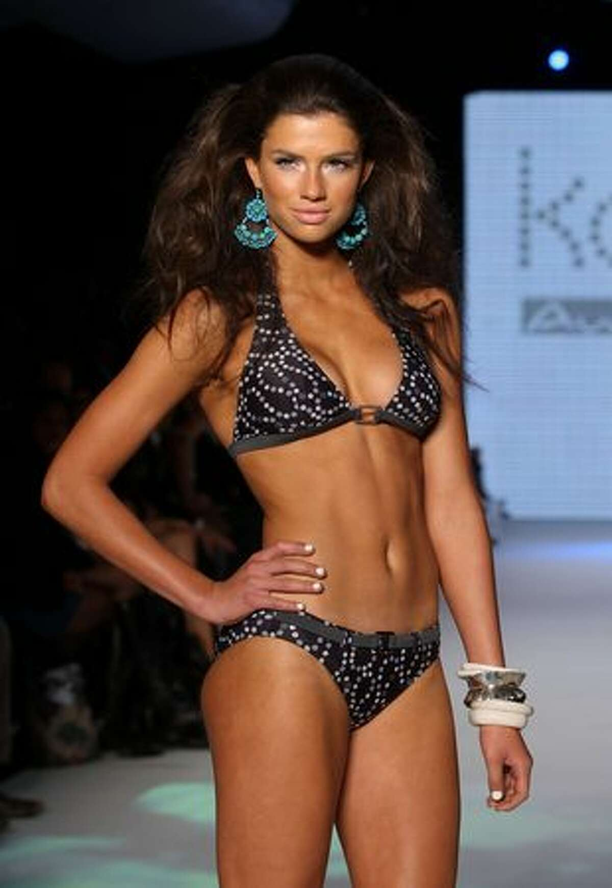 A model showcases designs on the catwalk during the Kooey collection show on the fourth day of Rosemount Australian Fashion Week Spring/Summer 2010/11 in Sydney, Australia.