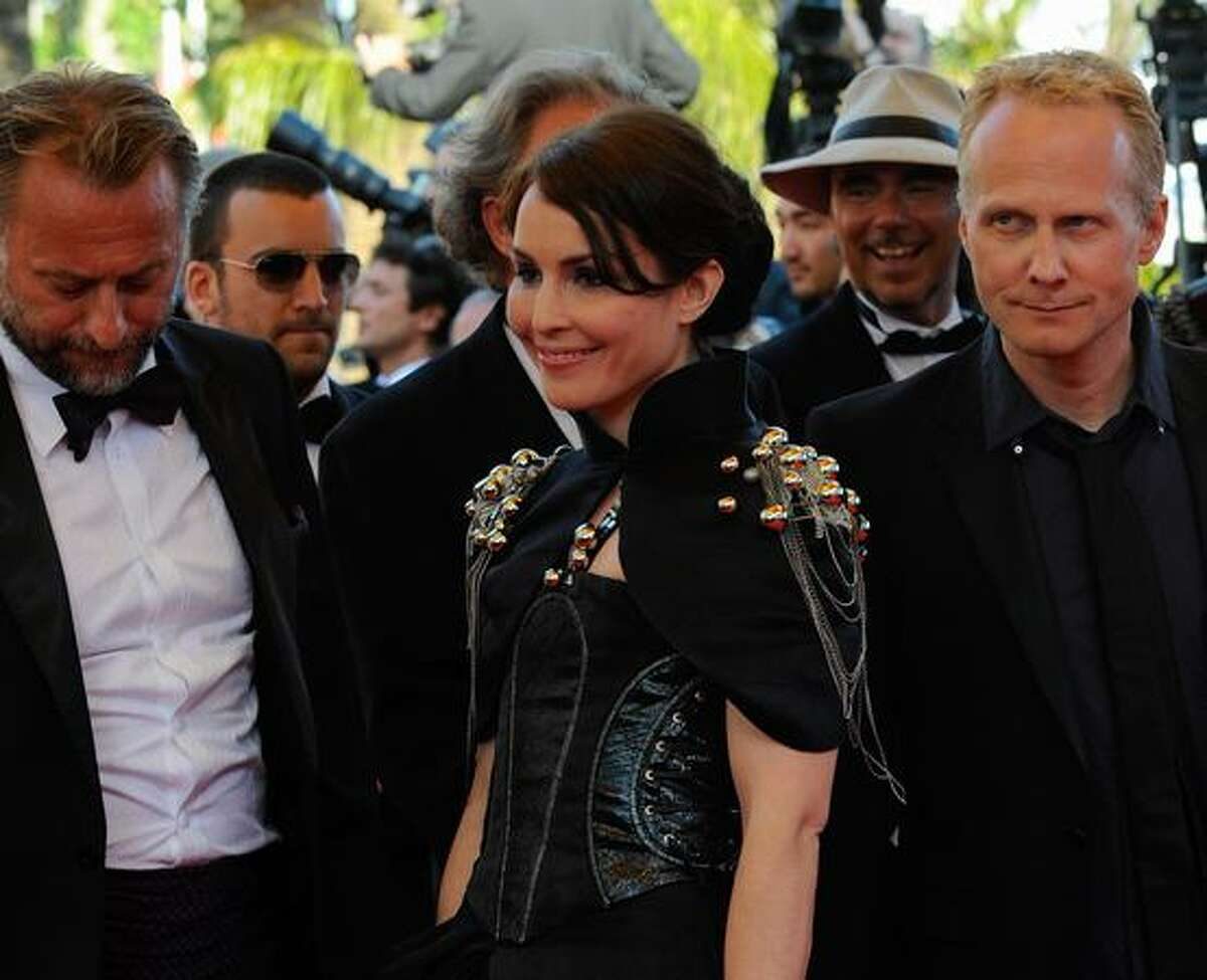 Swedish director Niels Arden Oplev (R), Swedish actors Noomi Rapace (C) and Michael Nyqvist (L), the crew of the Millenium film, arrive for the screening of the movie