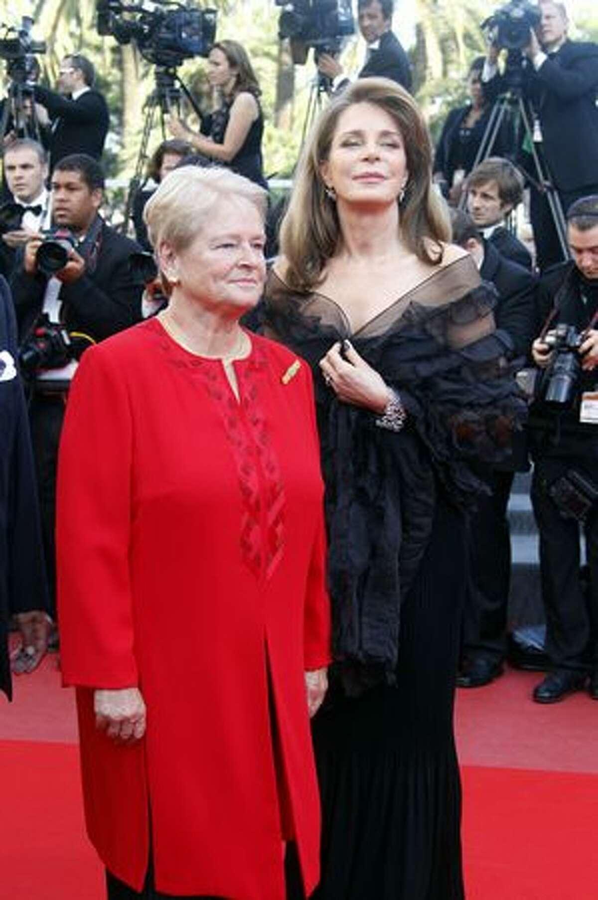 Queen Noor of Jordan (R) and former Norway's Prime Minister Dr Gro Bruntland (C) arrive for the screening of