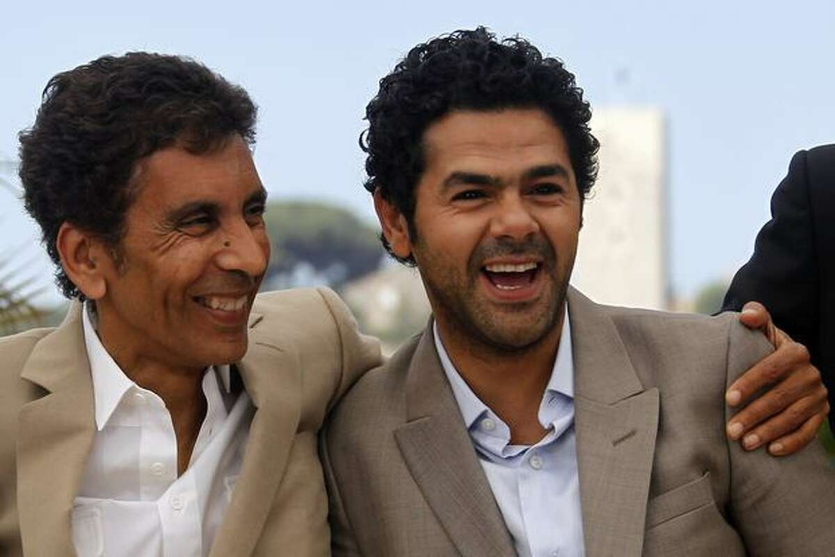 French director Rachid Bouchareb and French actor Jamel Debbouze pose during the photocall of
