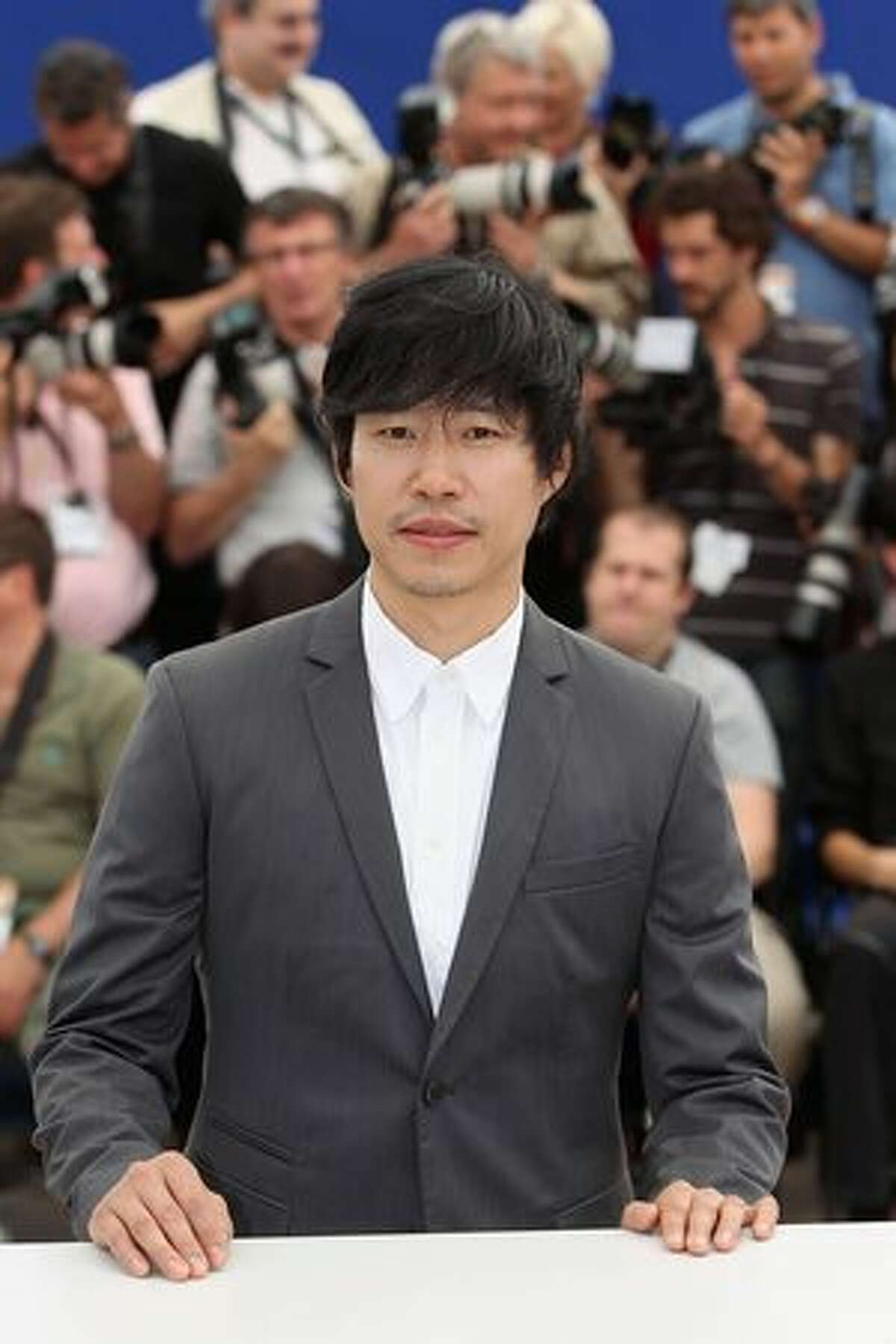Actor Joonsang Yu attends the 'Ha Ha Ha' Photocall at the Palais des Festivals during the 63rd Annual Cannes Film Festival.