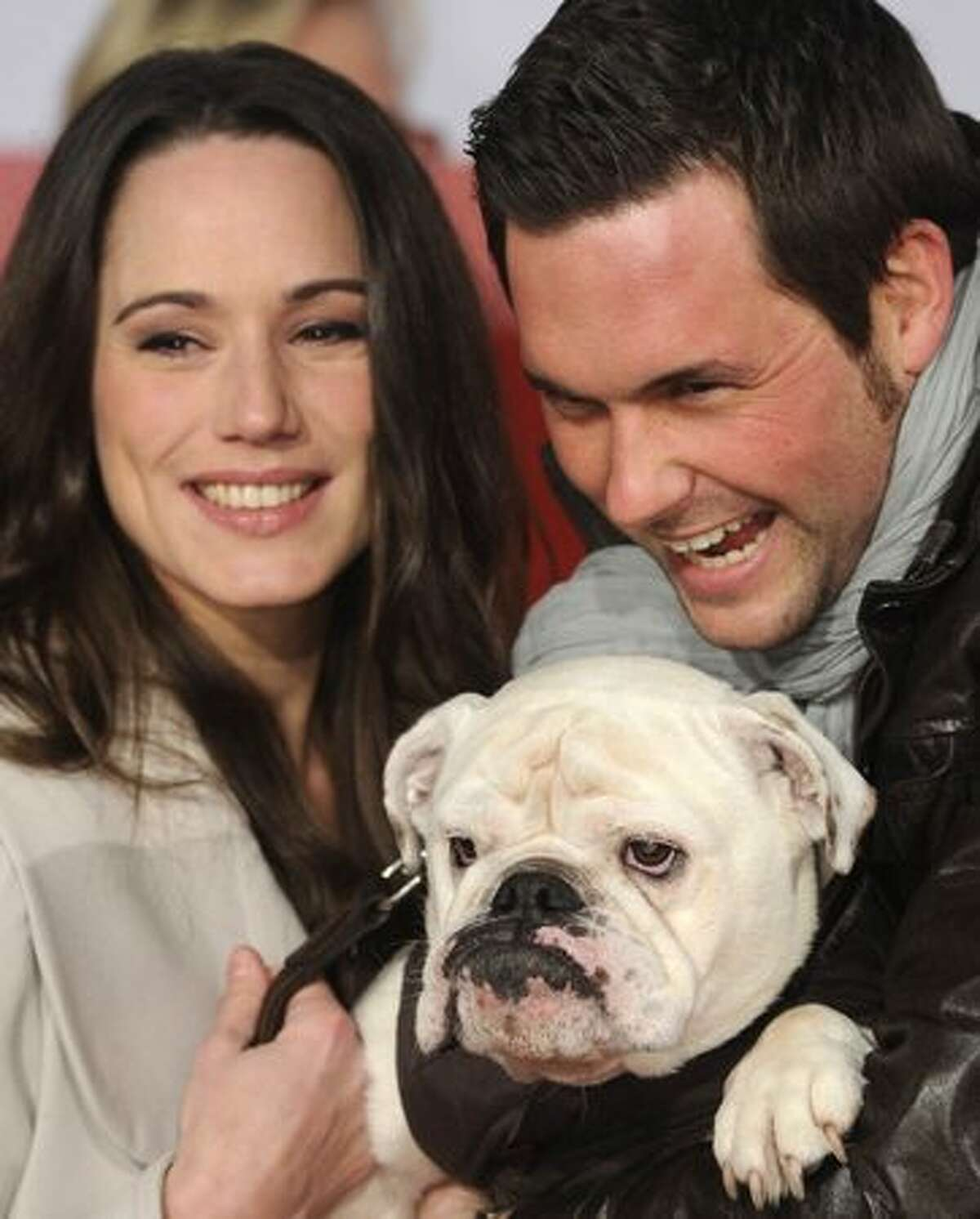German TV presenters Simone Panteleit and Matthias Killing pose with dog Lotte before the premiere of the movie