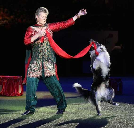 Dog trainer Mary Ray performs heelwork to music prior to the announcement of the 'Best in Show' at t