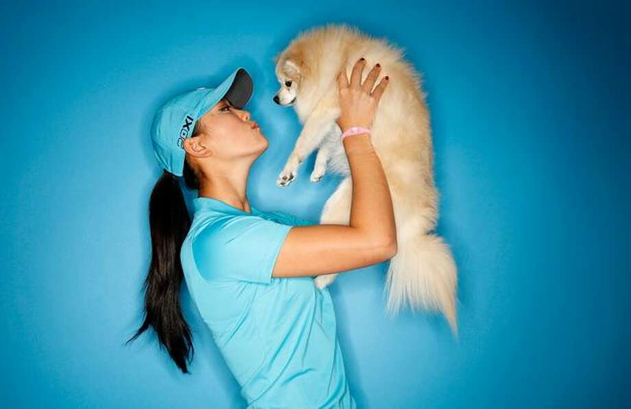 Golfer Michelle Wie poses for a portrait with her Pomeranian, Lola, on March 22, 2011 at the Industry Hills Golf Club in the City of Industry, California. Photo: Getty Images / Getty Images