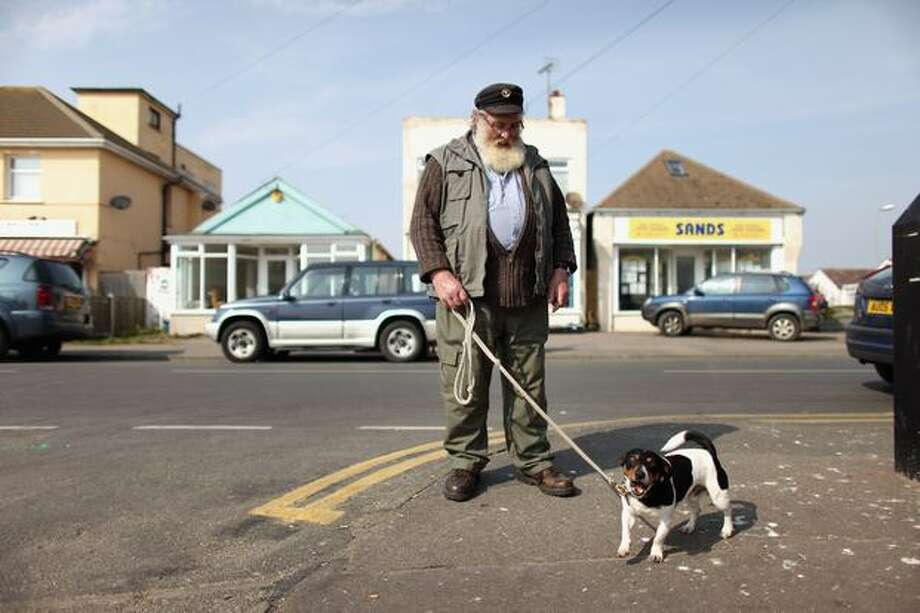 A man stands with his dog in the town of Jaywick, which has been named as the most deprived place in England, on March 25, 2011. The study, which is based on the Index of Multiple Deprivation, considered various indicators of deprivation including: unemployment, health and quality of housing. Photo: Getty Images / Getty Images