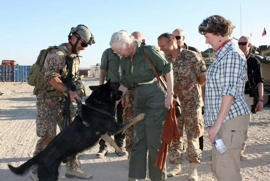 Denmark Queen Margrethe, second from left, and Denmark Minister of Defence Gitte Lillelund Bech, right, greet one of the Camp Price dog patrols in Helmand, Afghanistan, on Thursday, March 24, 2011. (AP Photo/Denmark Ministry of Defence) Photo: Associated Press / Associated Press