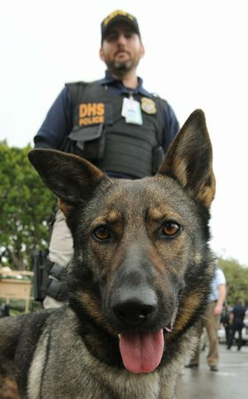 Department of Homeland Security Officer Curtin is pictured with his dog Sara during a media event after a training exercise involving an improvised explosive device (nuclear dirty bomb) in Los Angeles.