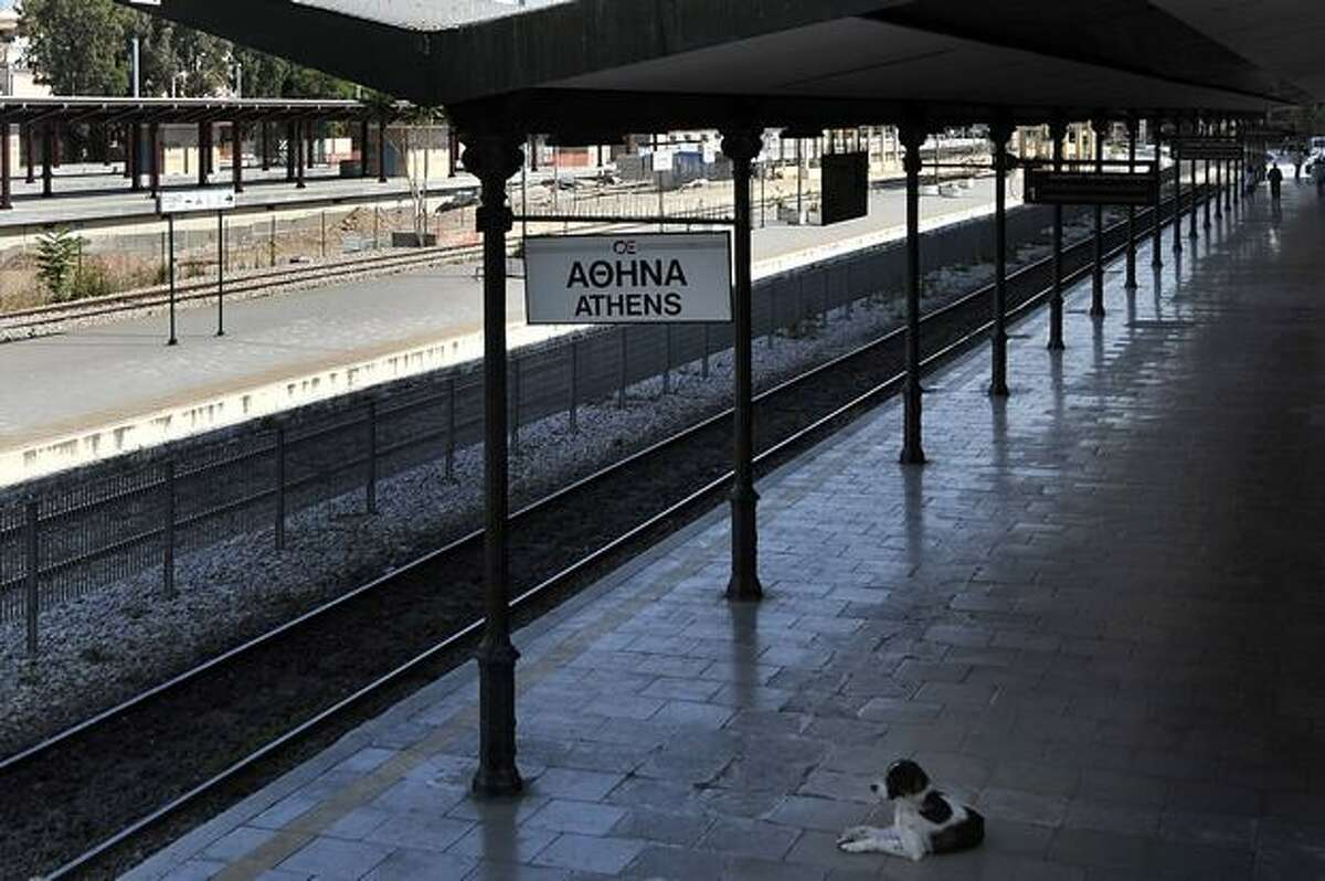 A stray dog rests at the empty Athens' train station during a 24-hour general strike. Greece on May 19 averted default by tapping into a multi-billion-euro EU loan rescue as unions geared up for a new general strike and official figures showed a strong rise in government debt.