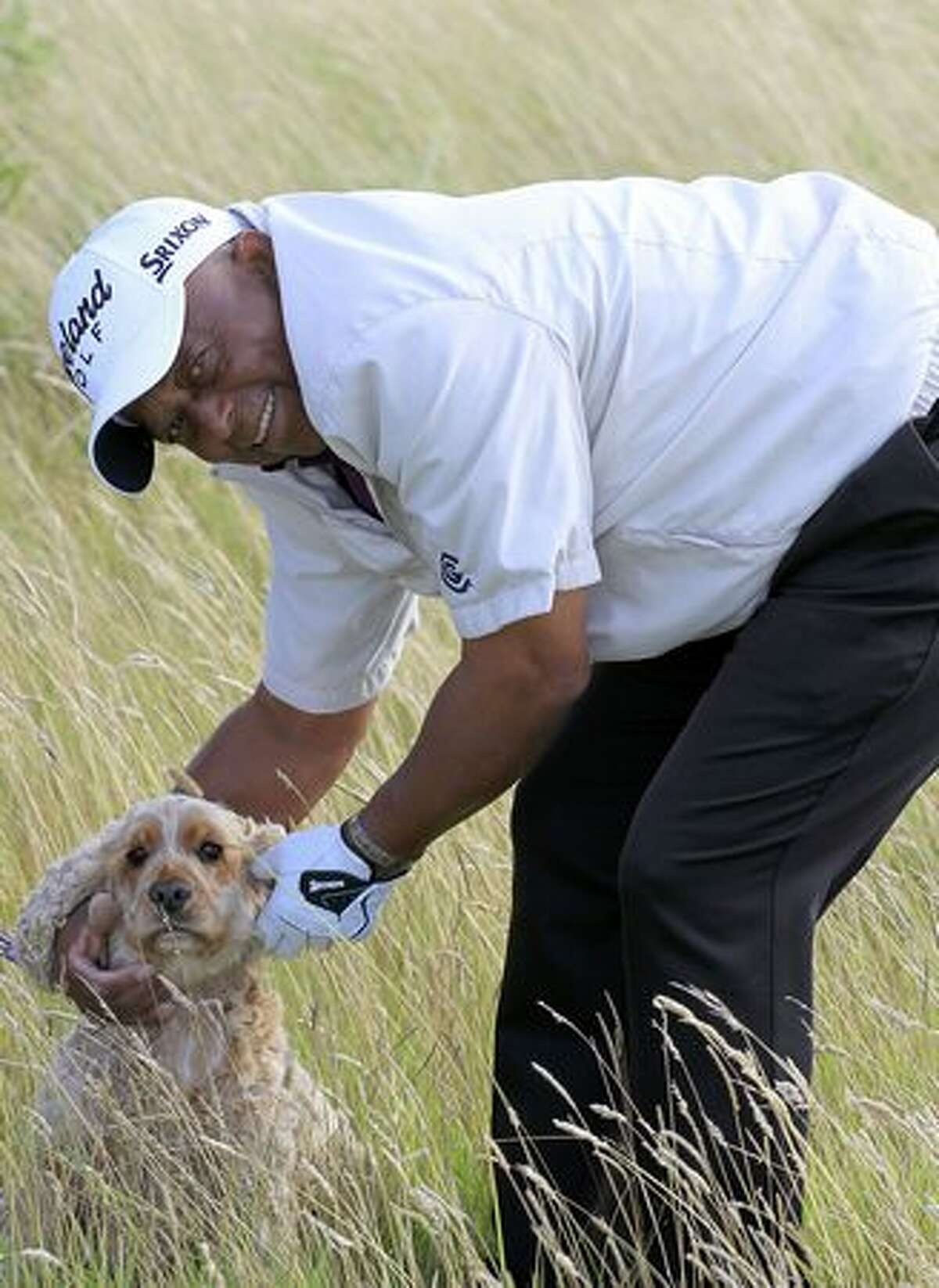 Jerry Bruner, of the U.S., greets a spaniel in the crowd during the final round of the Cleveland Golf Srixon Scottish Senior Open, on the Torrance Course at Fairmont St Andrews on August 22, 2010 in St Andrews, Scotland.