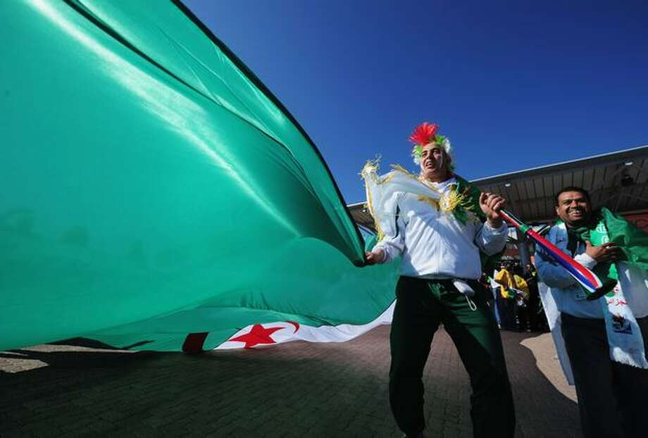 Algerian fans enjoy the atmosphere ahead of the 2010 FIFA World Cup South Africa Group C match between Algeria and Slovenia at the Peter Mokaba Stadium in Polokwane, South Africa on Sunday, June 13, 2010. Photo: Getty Images / Getty Images