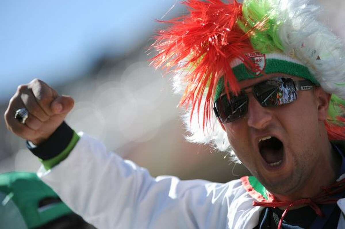An Algeria fan cheers before the start of the Group C first round 2010 World Cup football match Algeria versus Slovenia.
